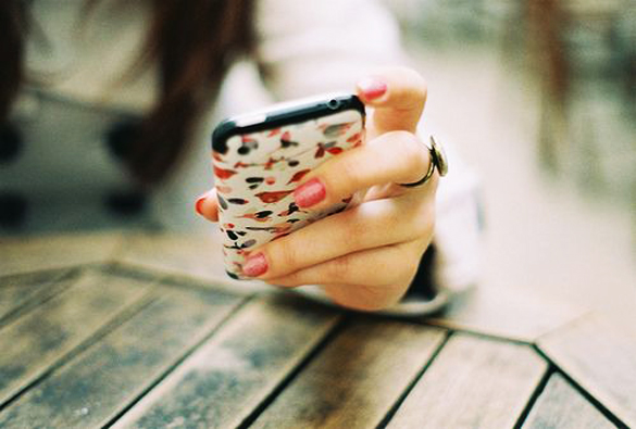 woman-hand-holding-a-cell-phone